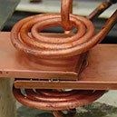 Induction brazing copper to copper lap joint.