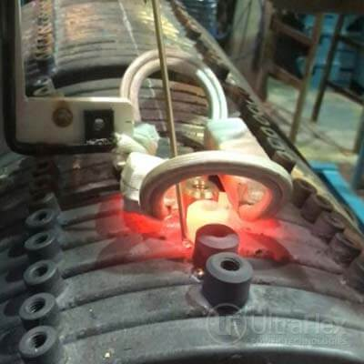 Induction brazing of brass studs to copper