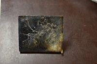 powder stainless steel ingots inside a custom copper mold