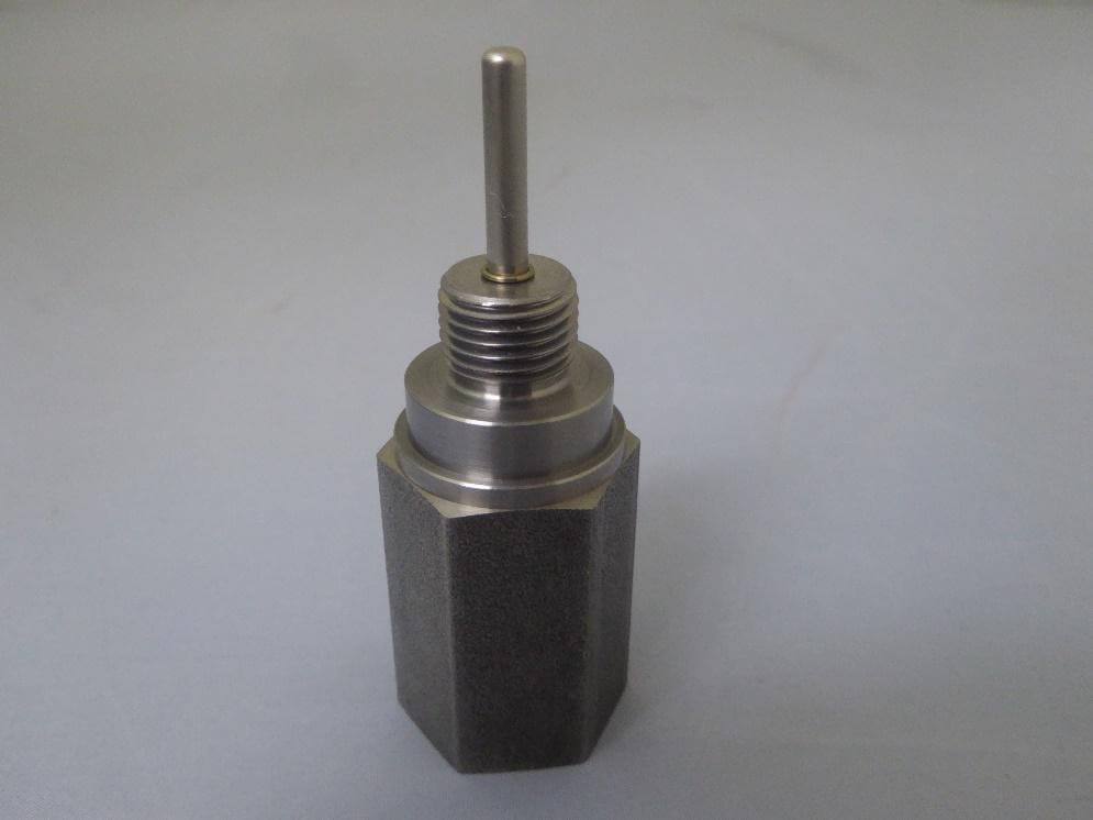 Induction brazing of stainless steel pin to a steel base